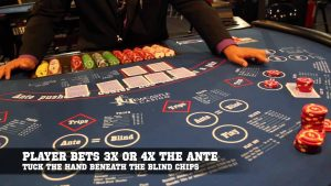 Ultimate texas hold'em table and dealer