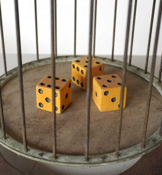 Three dice in a cage