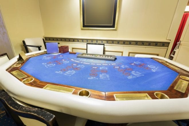 Ultimate texas hold 'em poker table at casino