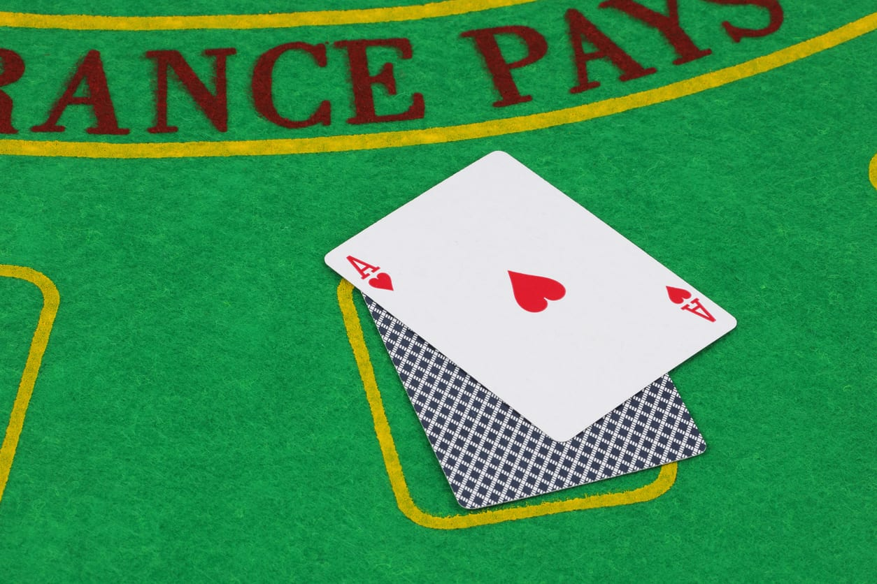 Blackjack Ace of hearts on card table winning hand business concept