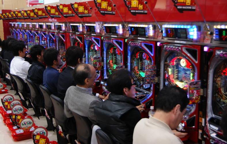 people playing pachinko games