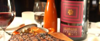 Steak and bottle of wine on a restaurant table