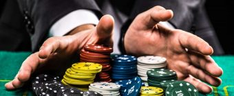 table game player collecting huge amount of chips